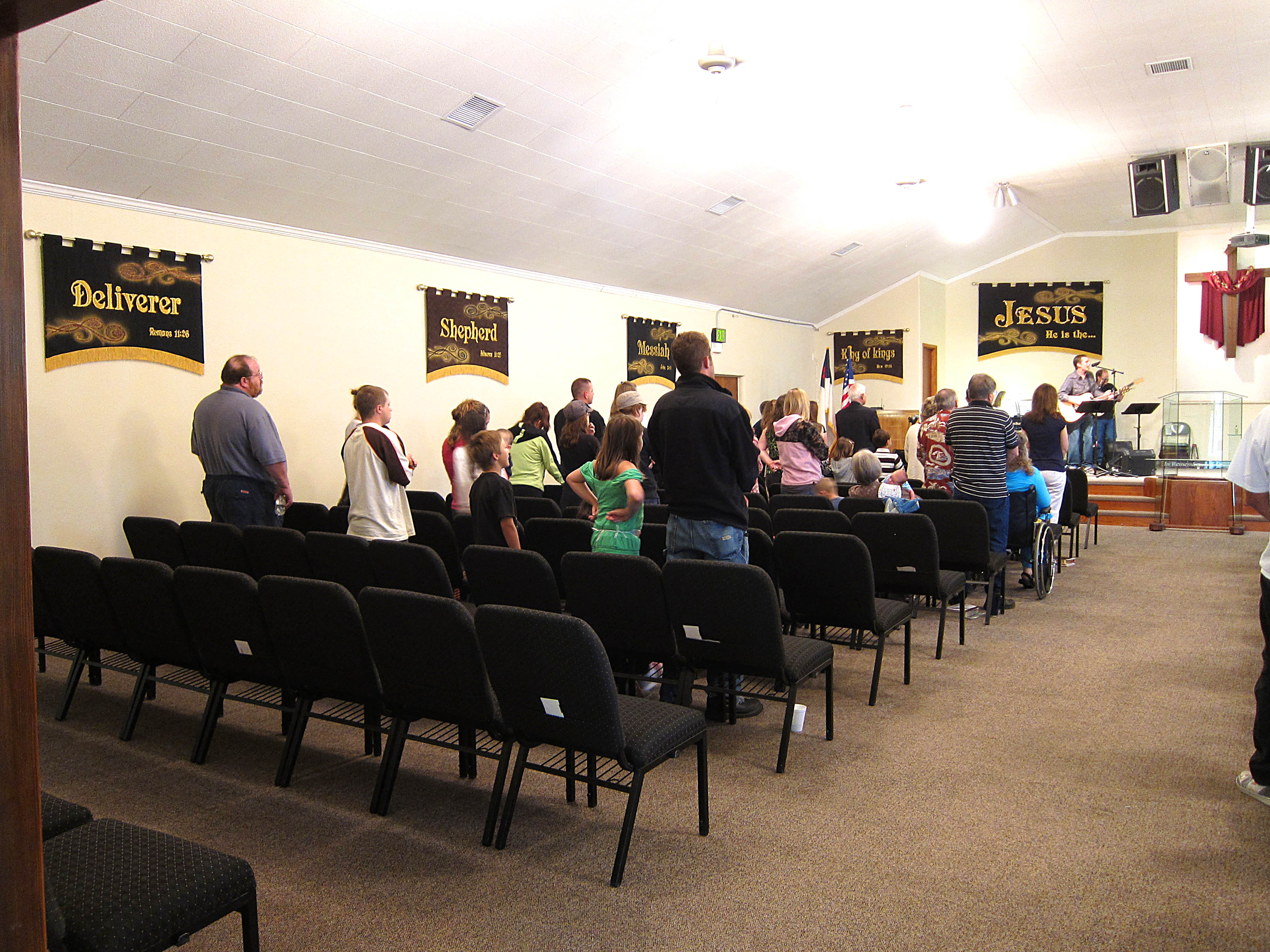 People Worshiping with the new Church Decorations featuring the Names of God Banners
